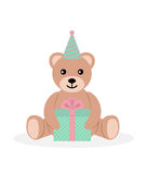 Toy bear with gift box on white background. Royalty Free Stock Image