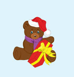 Toy bear with a gift for new year. Royalty Free Stock Photography