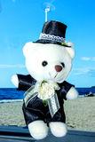 Toy bear the groom. Toy car. For the wedding. In the present Royalty Free Stock Images