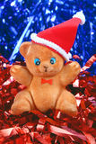 Toy bear in the hat of santa claus Stock Images