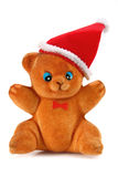 Toy bear in the hat of santa claus Stock Photo
