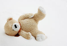 Toy bear lost in snow Royalty Free Stock Photos