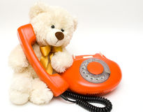 Toy bear and old phone Stock Images