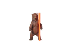 Toy bear with an orange marker. Stock Photos