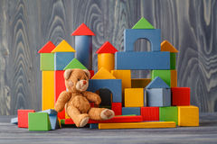 Toy bear and pile wooden building blocks stock photos