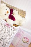 Toy bear is sitting on wicker basket Royalty Free Stock Photos