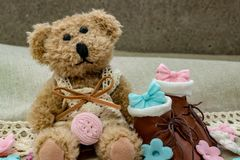 Toy bear with small brown shoes stock images