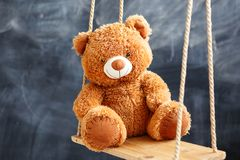 Toy bear on a swing Stock Photo