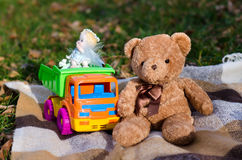 Toy bear and toy car. Toy brown Teddy bear and colorful toy car truck Royalty Free Stock Photography