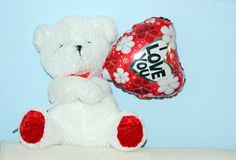 Toy bear with Valentine balloon Stock Photo