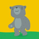 Toy bear walking on the grass Royalty Free Stock Photo