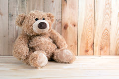 Toy bear on wooden floor Royalty Free Stock Photos