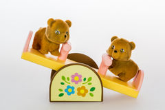 Toy bears on seesaw Royalty Free Stock Photos