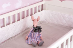 Toy on a bed in  a baby pink room Stock Image