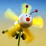 Toy bee. With wings in flight Royalty Free Stock Image
