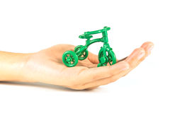 A toy bicycle in hand Stock Photography