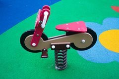 Toy bike. Rocking toy bike in playground Royalty Free Stock Image