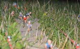 Toy cyclists displayed on a field Royalty Free Stock Image