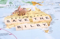 Toy bilby on map of Australia. MAGNITOGORSK, RUSSIA - JUNE 09, 2017: A photo with a toy bilby and letters on the map. Save the bilby concept stock image