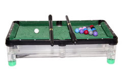 Toy billiards. The green broadcloth, billiard cue toy pool table Stock Photo