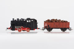 Toy black locomotive and coffee. Pictured items of a toy railroad Royalty Free Stock Photo