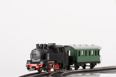 Toy black steam locomotive. Pictured items of a toy railroad Stock Photos