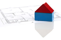 Toy block house on blueprint of floor plan Stock Photo
