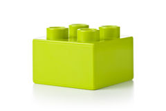 Toy Block. Plastic toy block, green color, on white background Stock Photos