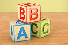 Toy blocks, abc cubes on the wooden table. 3D rendering. Toy blocks, abc cubes on the wooden table. 3D stock illustration