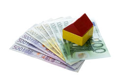Toy blocks house on euro money, household and financing concept Stock Images