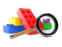 Toy blocks with magnifying glass Stock Images