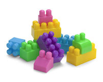 Toy Blocks Pile. Plastic Toy Building Blocks  on a White Background Stock Image