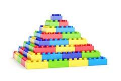 Toy blocks pyramid. Pyramid made of plastic toy blocks isolated on white background Royalty Free Stock Photos