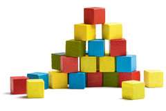 Toy blocks pyramid, multicolor wooden bricks stack. Isolated white background royalty free stock photography