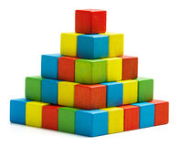 Toy blocks pyramid, multicolor wooden bricks stack. Isolated white background royalty free stock photos