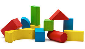 Toy blocks pyramid, multicolor wooden bricks stack. Isolated white background royalty free stock image