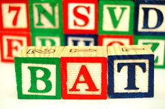 Toy Blocks - Spell. Wood toy blocks spell the word bat stock photography