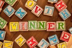 Toy Blocks Spell Winner de madera Imagen de archivo libre de regalías
