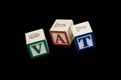 Toy blocks with work VAT Stock Image