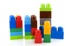 Toy blocs. Colorful plastic toy blocs isolated over white stock photos