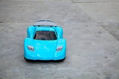 The toy blue car on asphalt road Royalty Free Stock Photos