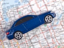 Toy blue car on vacation Royalty Free Stock Photos