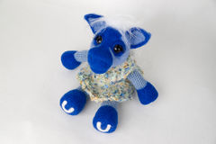 Toy blue horse in a gift. Toy blue horse on white background. Symbol of year on the Eastern calendar. Gift for holiday. Handmade Felt Stock Photo