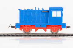 Toy blue locomotive one. Pictured items of a toy railroad Stock Photos