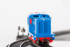 Toy blue locomotive two. Pictured items of a toy railroad Stock Photo