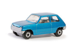 Toy blue model seventies french hatchback on white. Metallic blue model of French seventies hatchback car Royalty Free Stock Image