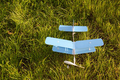 Toy blue plane airplane on green grass Stock Images