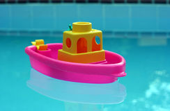 Toy Boat. Toy plastic boat in a pool Stock Image
