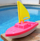 Toy Boat. A toy boat at the side of a swimming pool Royalty Free Stock Photography