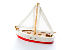 Toy Boat. Small toy boat contrasted on white background stock photos